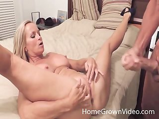 Good looking tow-headed gives a titjob and spreads her legs for screwing